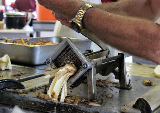 You clean the potato, then you put it in the, uh, musher, which produces pieces 4-5 inches in length. After 3 minutes in the fryer, these become Aggie Fries, served since 1952 by local Aggies at the West Texas Fair & Rodeo.