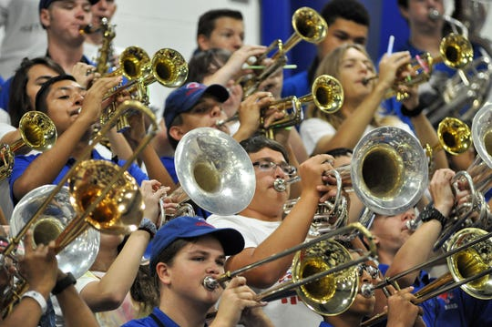 The Awesome Cooper Band performs during the Crosstown Showdown pep rally Sept. 13 at Cooper High School.