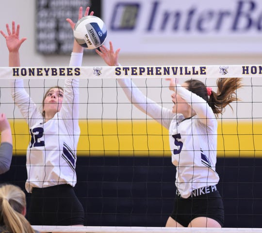 Wylie's Madison Burden (12) and Lilly Kate Doby (5) go up for a block against Stephenville on Friday, Sept. 13, 2019.