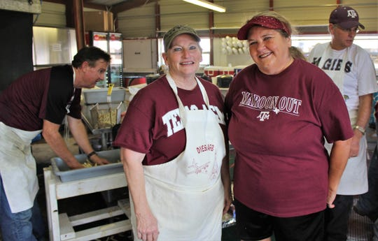 Roxanne Schoen, left, and Marta Hollowell again are co-chairAggies at the Aggie Fries booth at the West Texas Fair & Rodeo. Saturday is the last day to your fill for this year.