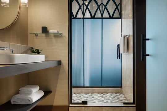 A view of the bathroom within a guest room at Kimpton Hotel Arras, a 19-story lodging and condominium project at 7 Patton Ave. being developed by John McKibbon and McKibbon Hospitality. The building features 128 guest rooms, including 28 suites, 54 condo units, restaurants and meeting space.