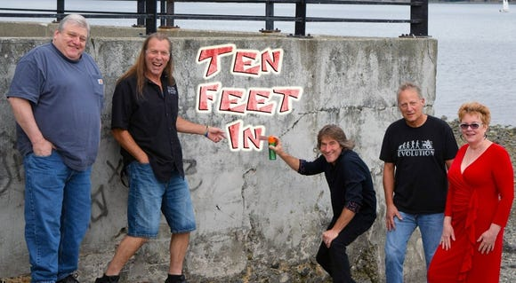 Ten Feet In play rock covers Sept. 25 at the Dugout Sports Bar and Grill in Bremerton.