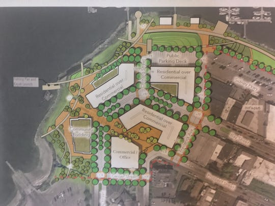 This photo of a conceptual design on display Sept. 12, 2019, in Port Orchard City Hall shows a master plan for redevelopment at the west end of Bay Street, including new privately funded buildings, a publicly-funded community center and shoreline restoration. The master plan was initially proposed by Steve Sego of Waterman Investment Partners LLC, one of the principals in the private development group.