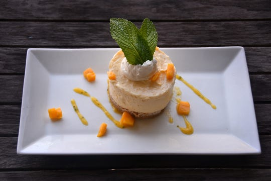 Mascarpone Cheesecake with Mint Mango Puree at River Rocks in Rockledge.