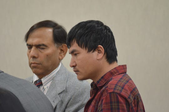 Murder suspect Aita Gurung, right, appears in Vermont Superior Court in Burlington on Friday, Sept. 13, 2019.