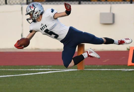 Veterans Memorial's Bradley Burda jumps for a touchdown at the game against King, Thursday, Sept. 12, 2019, at Buc Stadium. Veterans Memorial won, 57-6.