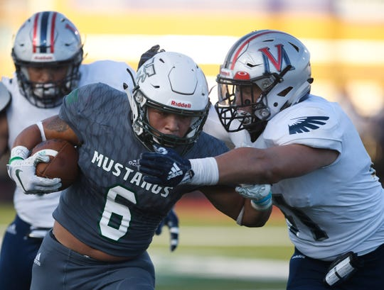 Veterans Memorial defensive lineman #41 Daylan Pena tackles King running back Nathaniel Guy. Veterans Memorial won 57-6 on Thursday, Sept. 12, 2019, at Buc Stadium.