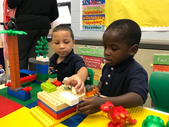 Jayden Marrero (left) and Tremaine Miller Jr. build something together at RT Cream School in Camden.