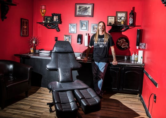 "Danny ""Doodle"" Derreberry poses in his tattoo shop Wicked Sensations, which he opened in Chillicothe 20 years ago."