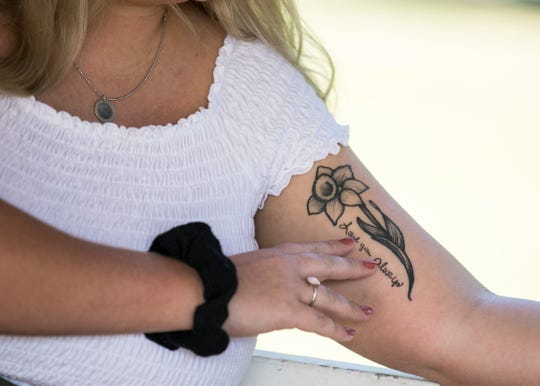 Sidra Greenwald has numerous tattoos that have special meaning to her but the one of a daffodil on her left arm has special meaning to her and is a way to keep her mother Janet Detty Gorrell close to her heart after she passed away in March from cancer.