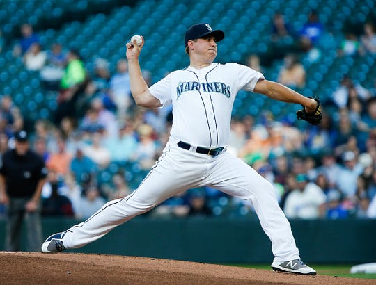 Erik Swanson of the Seattle Mariners delivers in the first inning against the Detroit Tigers at T-Mobile Park on July 25, 2019 in Seattle, Washington.