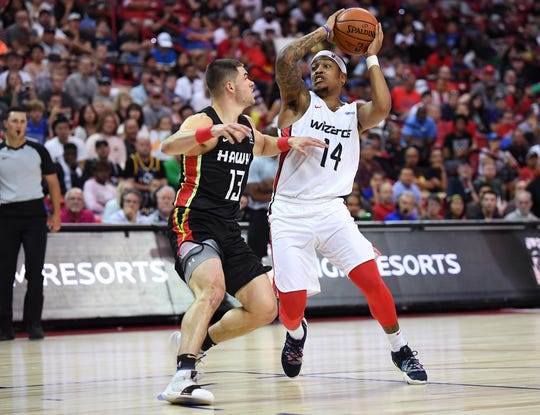 Washington Wizards guard Troy Caupain (14) looks to pass the ball while defended by Atlanta Hawks guard Matt Mooney (13) during the second half of an NBA Summer League game at Thomas & Mack Center on July 11.