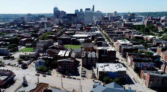 An aerial view of Over-the-Rhine near Liberty Street, looking toward downtown Cincinnati. Despite significant redevelopment and growth in Over-the-Rhine, the neighborhood remains home to some of the city's poorest residents.