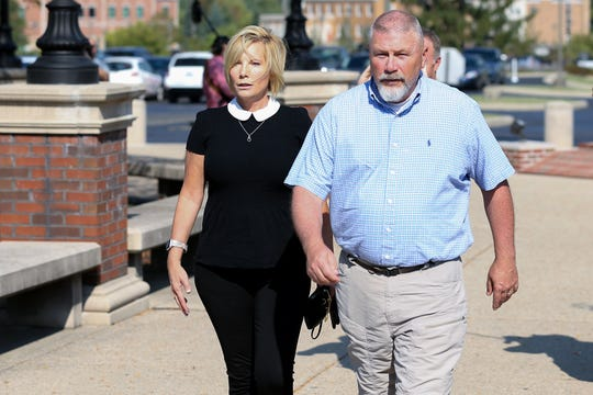Kim and Scott Richardson, parents of Brooke Skylar Richardson, walk into the courthouse before their daughter was sentenced to three years community or control, or probation, and seven days of time served after bring round guilty of gross abuse of a corpse, Friday, Sept. 13, 2019, in Warren County Judge Donald Oda's II courtroom at Warren County Common Pleas Court in Lebanon, Ohio.