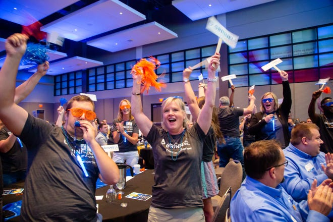 Employees from Grinnell Mutual cheer as they're announced at Des Moines Register's Top Workplaces awards Thursday, Sept. 12, 2019.