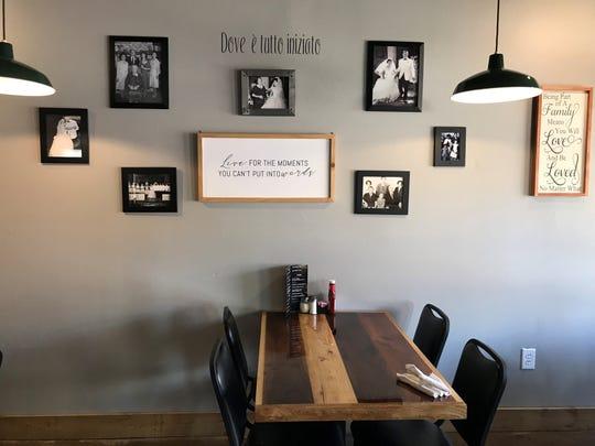 Family photos adorn the walls of Coco & Nini's.