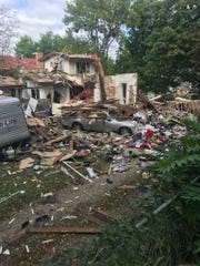 A home was destroyed in an early-morning explosion on Friday, Sept. 13, 2019, in Des Moines. Several other homes were damaged, but there were no injuries reported, police said.
