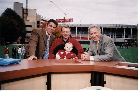 Iowa State senior associate athletics director Steve Malchow (center) before the 2003 GameDay when he worked at Wisconsin. He's holding his son, Bryce. At left is host Chris Fowler, and at right is Lee Corso.