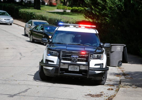 Police line a section of Terrace Road on Friday, Sept. 13, 2019, in Des Moines as they search the area after receiving reports of a shooting in the area.