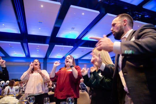 Employees from Housby cheer as they're announced at Des Moines Register's Top Workplaces awards Thursday, Sept. 12, 2019.