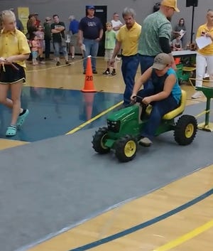 Ashton Binder competes at the state tractor pedal pull competition in Marshalltown, Iowa Sept. 7. He placed third.