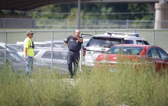 Police work an area along the railroad tracks behind Central Campus School on Friday, Sept. 13, 2019, in Des Moines after receiving a call about a shooting in the area.