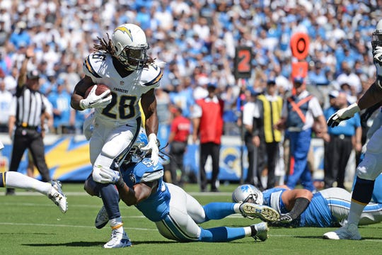 Chargers running back Melvin Gordon is defended by Lions linebacker Josh Bynes on Sept. 13, 2015 in San Diego.