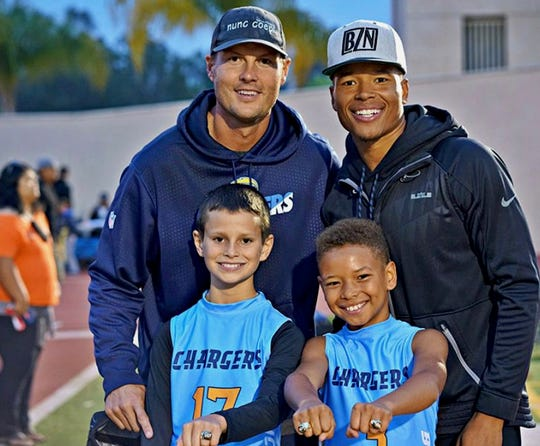 The sons of Marvin Jones and Philip Rivers play on the same flag football team together.