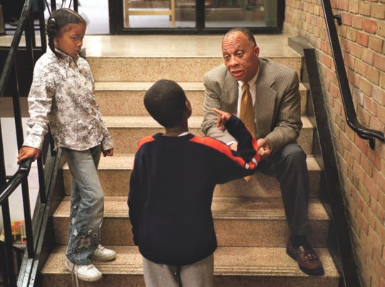 Friends School of Detroit headmaster Dwight Wilson right, talks with third grade students who where involved in an incident on the playground earlier in that day, in October, 2002.