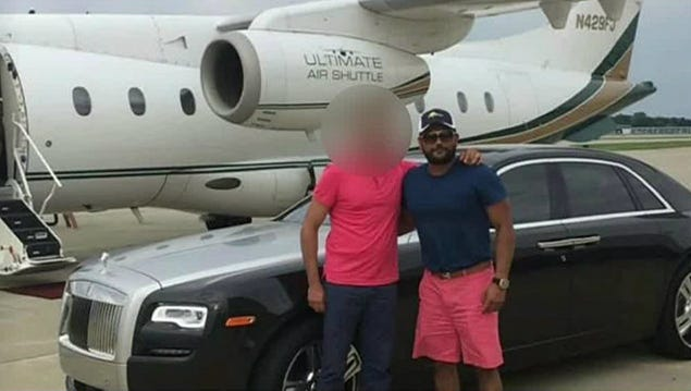West Bloomfield businessman Mashiyat Rashid convicted in 2018 of running a $150 million scheme involving opioids, poses in front of a private jet and his Rolls Royce. Prosecutors said the scheme bankrolled his lifestyle and used this photo as evidence against him. Rashid is pictured on the right. This image has been redacted by the US Attorney's Office.