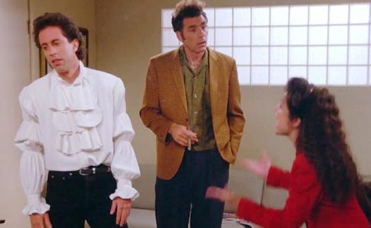 """Jerry Seinfeld, Michael Richards and Julia Louis-Dreyfus in the """"puffy shirt"""" episode of """"Seinfeld"""""""