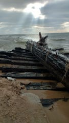 The remnants of a Lake Michigan shipwreck – possibly the schooner Contest, lost in 1882 – were exposed by high water and harsh winds near Whitehall in December.