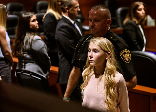 "Brooke ""Skylar"" Richardson is escorted out of the courtroom after the verdict in her trial at Warren County Common Pleas Court Thursday, Sept. 12, 2019  in Lebanon, Ohio."