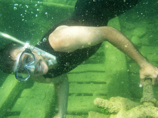 State Maritime Archaeologist Wayne Lusardi snorkels through the wreckage of the Portsmouth, which sits in seven or eight feet of water on the shore of Middle Island in Lake Huron.