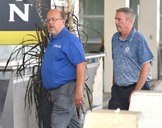 United Auto Workers Region 1 Director Frank Stuglin, left and Director Chuck Browning, Region 1A, return to the entrance to the Westin Detroit Metropolitan Airport Hotel after taking a break from a meeting with high-level UAW officials around 4 p.m. Friday afternoon, September 13, 2019. International board members work to determine the way forward after Region 5 Director Vance Pearson was indicted on federal charges earlier this week and UAW President Gary Jones and former UAW President Dennis Williams were involved federal probe.