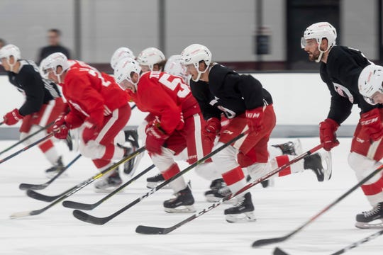 Red Wings players skate through drills during practice on Friday in Traverse City.