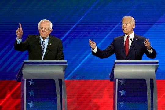 Sen. Bernie Sanders, I-Vt., left, and former Vice President Joe Biden, right, speak Thursday, Sept. 12, 2019, during a Democratic presidential primary debate hosted by ABC at Texas Southern University in Houston.