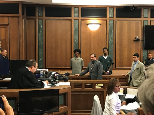 Demaurio Dismuke, 14, of Detroit (left) and Jamel Marquise Philson, 17, of Highland Park, (right) appear in 19th District Court in front of Judge Mark W. Somers for arraignment on Friday, Sept. 13, 2019.