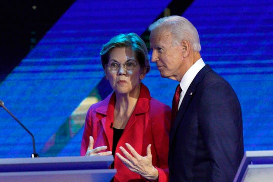 Democratic presidential candidates Sen. Elizabeth Warren, D-Mass., left, and former Vice President Joe Biden talk during a break Thursday, Sept. 12, 2019, in a Democratic presidential primary debate hosted by ABC at Texas Southern University in Houston.