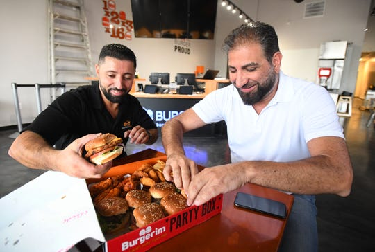 Burgerim general manager Rony Younes and founder Sam Zahr with a takeout from one of his other Burgerim restaurants in Oak Park, Michigan  on September 13, 2019.