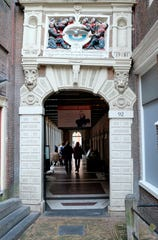 Visitors enter the Amsterdam Museum in Amsterdam, Friday, Sept. 13, 2019.