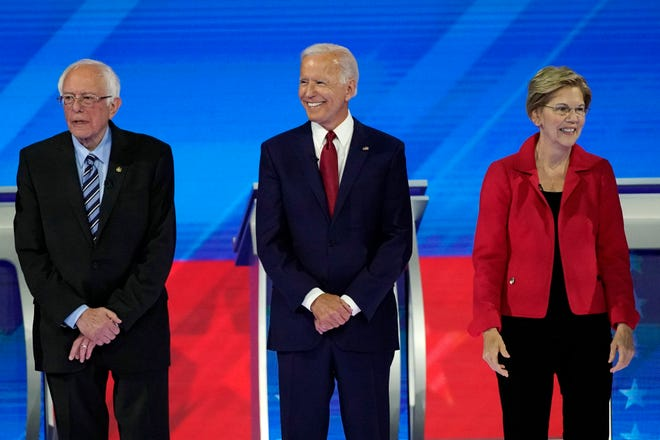 From left, presidential candidates Sen. Bernie Sanders, I-Vt., former Vice President Joe Biden and Sen. Elizabeth Warren, D-Mass., are introduced Thursday, Sept. 12, 2019, before a Democratic presidential primary debate hosted by ABC at Texas Southern University in Houston.