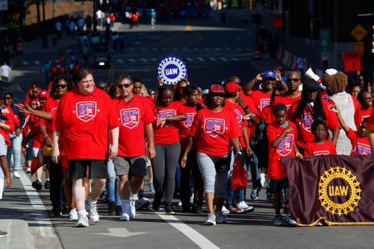 United Auto Workers members march in Detroit's Labor Day parade.