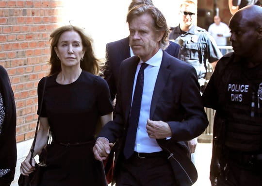 Felicity Huffman arrives at federal court with her husband William H. Macy for sentencing in a nationwide college admissions bribery scandal on Friday in Boston.