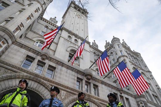 Police stand guard outside the Trump International Hotel on Pennsylvania Avenue in Washington.