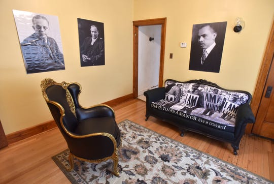Daniel Baxter commissioned local Detroit restoration expert Lisa Milton to restore furniture in the Ossian Sweet residence. Portraits of civil-rights icons, left to right, are Walter White, Clarence Darrow, James Weldon Johnson.