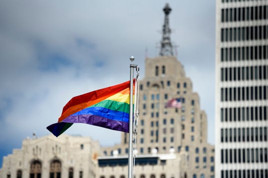 A rainbow flag flies at Motor City Pride in Detroit's Hart Plaza in 2018.