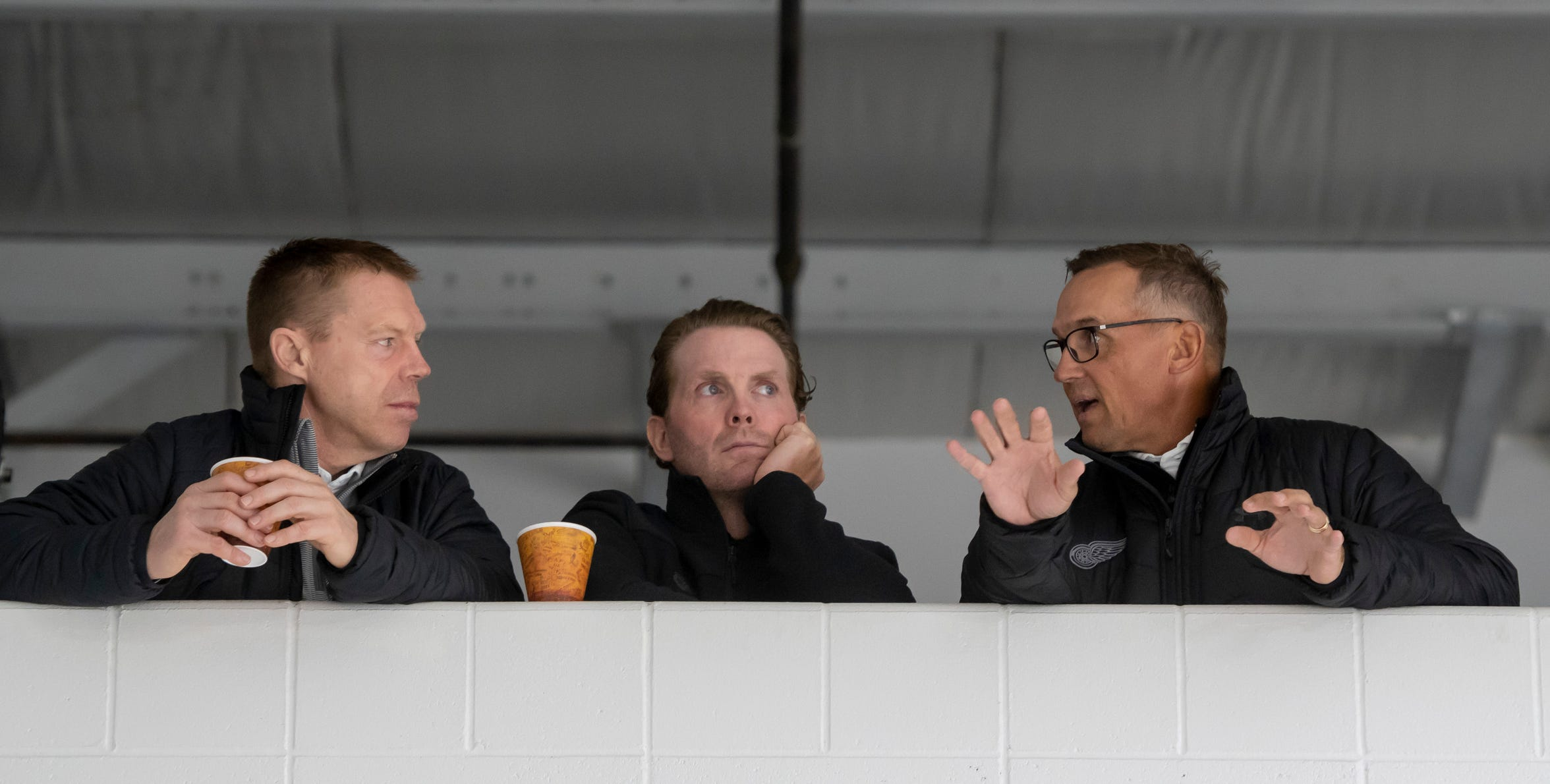 (From left) Director of Amateur Scouting Kris Draper, Assistant Director of Player Development Dan Cleary, and General Manager Steve Yzerman chat during the Red Wings training camp at Centre Ice Arena, in Traverse City.  All three were former players.