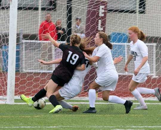 Elmira's Emily Hanrahan (19) tries to knock the ball in the net as Corning girls soccer players, from left, Abby Dejneka, Laura Wentzel and Gillian Mason defend Sept. 12, 2019 at Ernie Davis Academy.