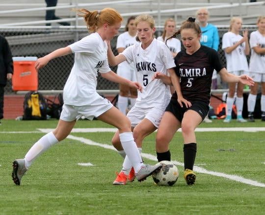 Corning's Gillian Mason, left, and Lauren Gerow (5) battle for possession with Elmira's Mandy McCarick in girls soccer Sept. 12, 2019 at Ernie Davis Academy.